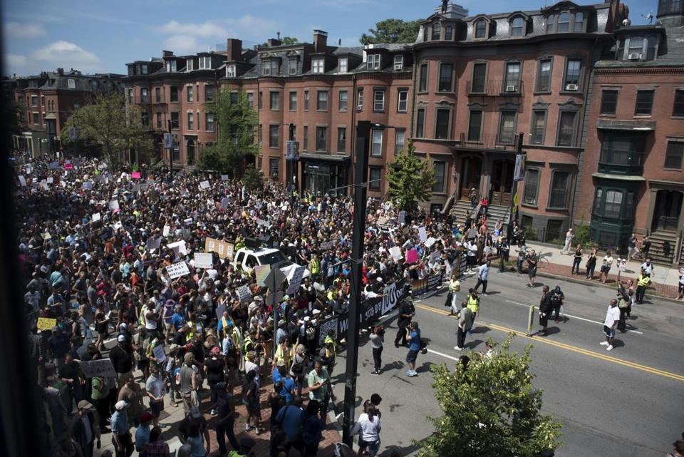 Boston, MA - 8/19/17 - Marchers on the way toward Boston Common during a march from Roxbury to the Boston Common as part of a counter-protest to a free speech rally being held there on Saturday, August 19, 2017. This day's protest occurred as part of the ongoing national outrage after protests in Charlottesville, Virginia turned deadly last weekend, primarily in opposition to what's seen as a rise in prominence and visibility of white supremacists and Neo-Nazis. (Nicholas Pfosi for The Boston Globe) Topic: 20rally photos (only)